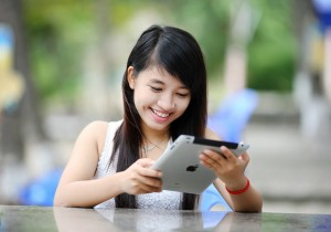 smiling woman on tablet
